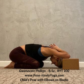Childs Pose with elbows on blocks on Pose-itivelyYoga.com