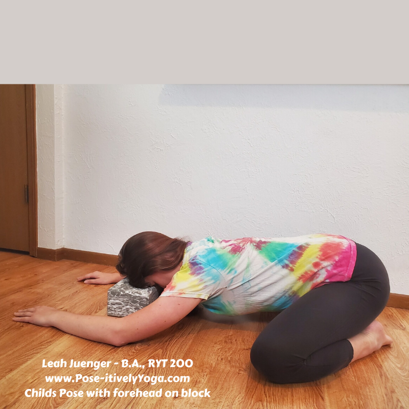 Childs Pose Forehead on Block on Pose-itivelyYoga.com